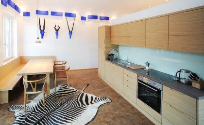 dolomit24 Appartement - Küche und Essbereich