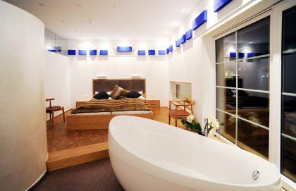 dolomit24 Appartement - Bade- und Schlafbereich
